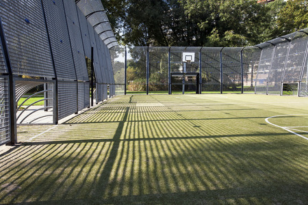 Soccer and basketball cage with artificial turf Stockfoto