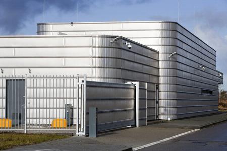 Well secured metal industrial building Foto de archivo