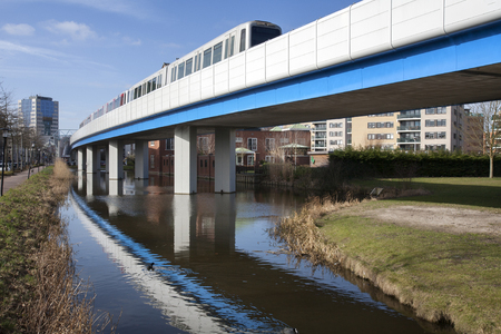 The subway  connection from Rotterdam to Capelle aan den IJssel.  The building on the left is the city hall of Capelle aan den IJssel . In Rotterdam the subway goes underground.