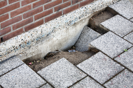 Road subsidence, danger to the pedestrians in this street Archivio Fotografico