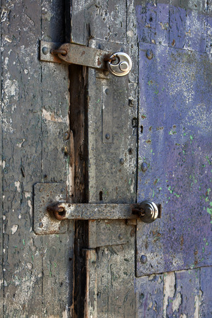 padlocks: Padlocks on an old wooden door