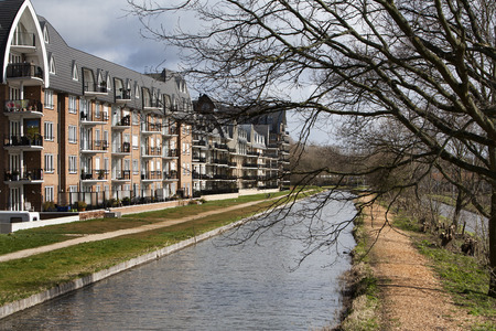residential district: Nice Apartments in an apartment block with water view. Theres a woodchips footpath along the water. This residential district is located in Voorschoten in the Netherlands.