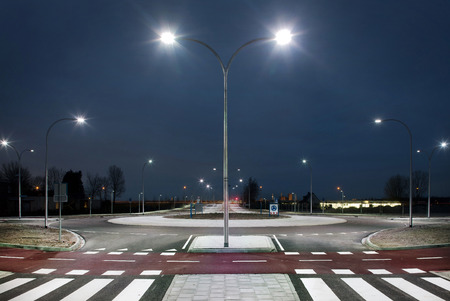 Roundabout illuminated by LED lights in the twilight zone Archivio Fotografico