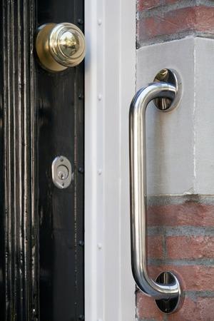 grab: Safety grab handle near a door