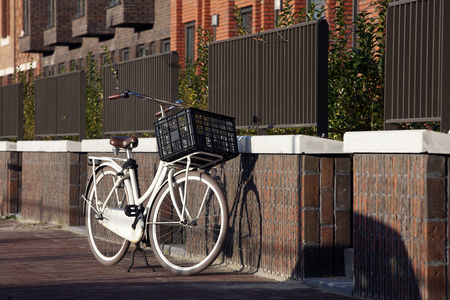 condominium complex: White transport bike with crate in residential district Rotterdam Crooswijk, the Netherlands Stock Photo