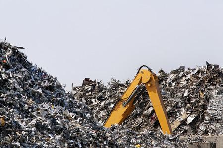 metal scrap: This brand new crawler excavator looks buried in the metal scrap