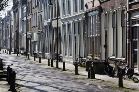 row of houses: Crooked street with row houses in Gouda in the Netherlands