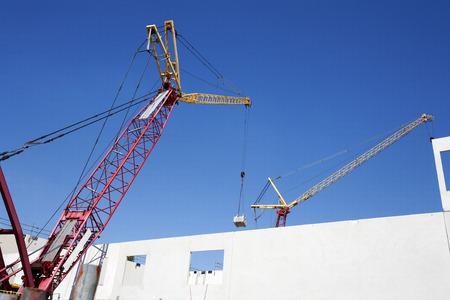 construction materials: Crane lifting construction materials