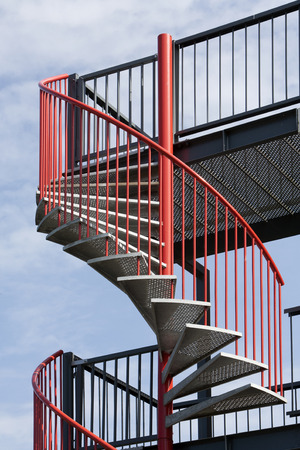 steps and staircases: Red metal spiral staircase in the Netherlands