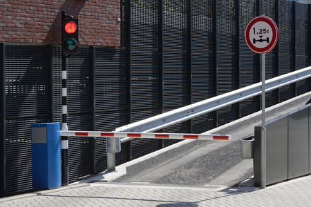 tonnage: Parking garage ramp with barrier and a red light. Wait for the green light. Stock Photo