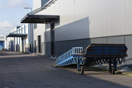 industrial district: Blue mobile ramp for truck in an industrial district Stock Photo