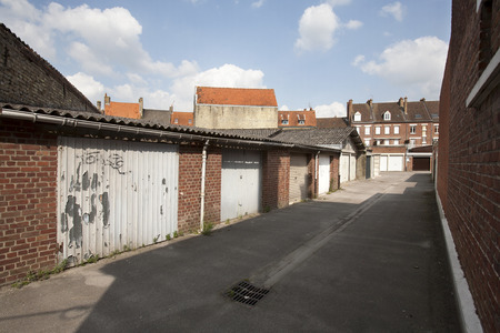 backstreet: Garage doors at the backside of the houses in Bergues, France