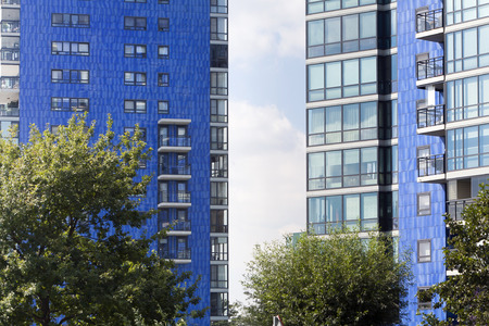 apartment blocks: Blue apartment blocks on a green location