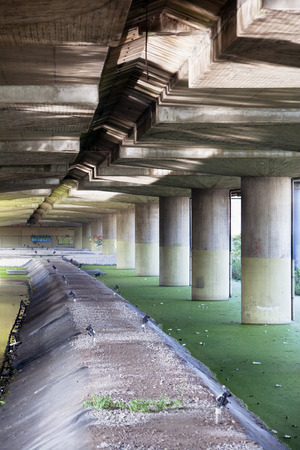 elevated: Pillars under an elevated road Stock Photo