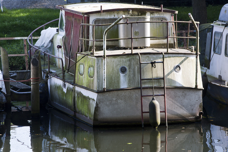 environmental damage: Scummy boat protected by a buoy