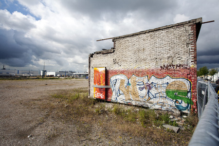 Graffiti on the wall of a abandoned industrial building Stock Photo