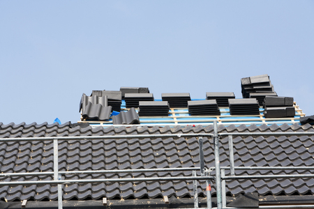 roofer: Roof tiles waiting for the roofer Stock Photo