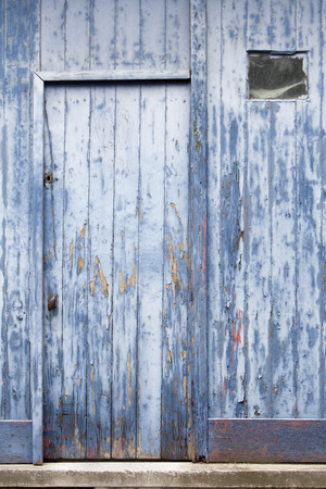 peeling paint: Blue peeling paint door background Stock Photo