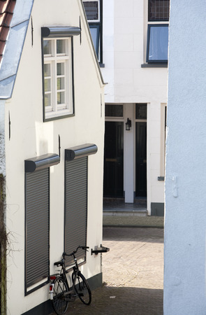 white house: Rolling shutters on a small dutch house Stock Photo