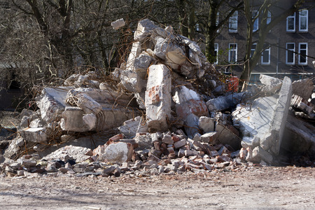 residential district: Demolition of a residential district in the Netherlands. Wall parts and other rubble waiting to be transported