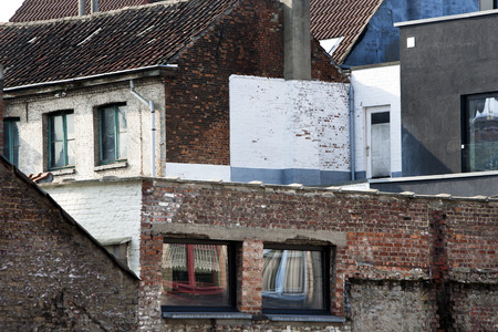 residential neighborhood: Residential neighborhood of old brick houses built close together in Mechelen, Belgium.