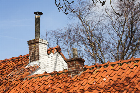 close up chimney: Chimneys on a roof with red roof tiles