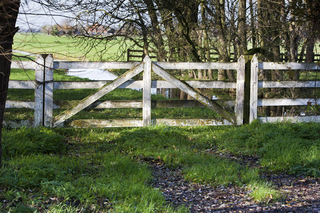 pasture fence: Idyllic white pasture fence gate Stock Photo