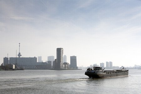 Barge on the river Meuse in Rotterdam.  With the Euromast in the background on the left side.