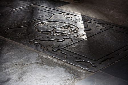 breda: Centuries old worn tombstone in the Great Church, or Church of our Lady in Breda, in the Netherlands