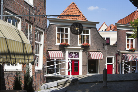 awnings: Street in Delft in the Netherlands Stock Photo