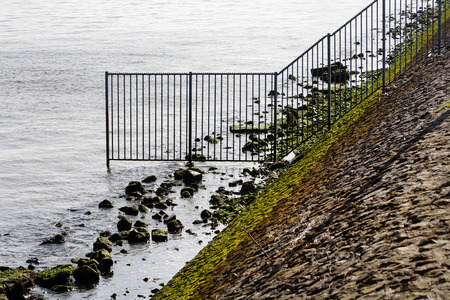 meuse: Security fence in the river Meuse in Rotterdam against trespassing