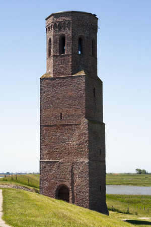 16th century: Plompe toren in Burg-Haamstede, the Netherlands. Once, the tower was part of the village Koudekerke.  Koudekerke disappeared in the sea at the end of the 16th century