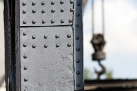 rivets: Solid steel with rivets crane and a crane hook