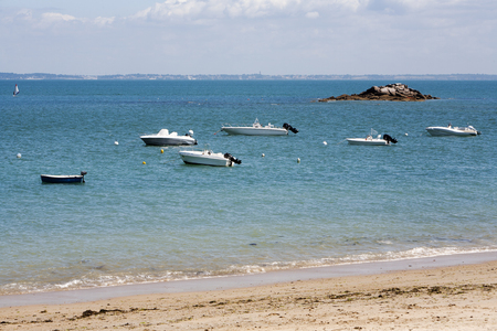 motorboats: White motorboats moored on sea at Noirmoutier island in France