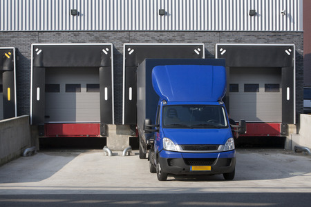 backdoor: Warehouse loading dock and a blue truck