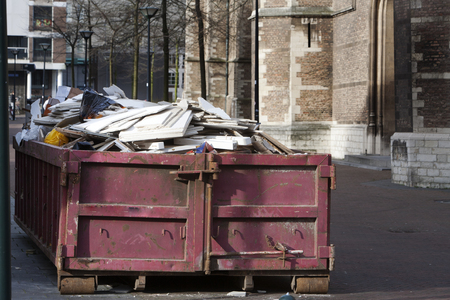 demolish: Container loaded with demolished construction material