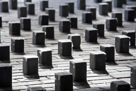 wanderers: Upstanding paving stones against sleeping wanderers