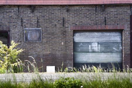 exterior: Brick wall with a grunge garage door