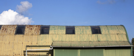 corrugated iron: Old yellow green shed made from corrugated iron sheets