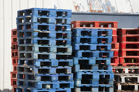 timberland: A stack of blue and red wooden pallets