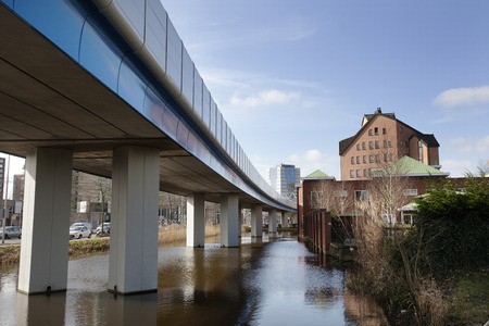 The subway  connection from Rotterdam to Capelle aan den IJssel.  The building in the middle is the city hall of Capelle aan den IJssel . In Rotterdam the subway goes underground. Stockfoto