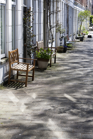 residential district: The residents have placed benches in front of their houses in this cozy street in the residential district Kralingen in Rotterdam, the Netherlands.