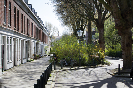 residential district: Winding street in  residential district Kralingen in Rotterdam, the Netherlands.