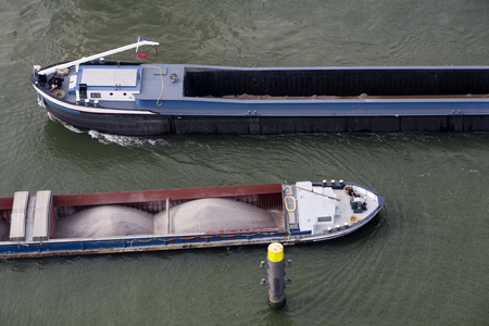 bulk: Two barges loaded with bulk passing on the River