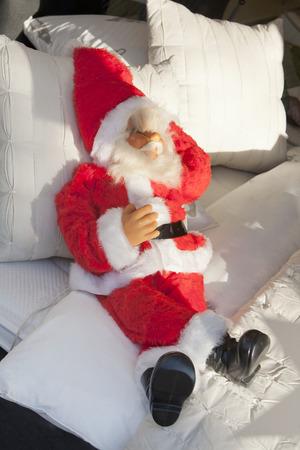 dressing up costume: sleeping santa Stock Photo