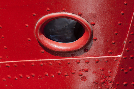ship bow: Port Hole in the bow of a red ship