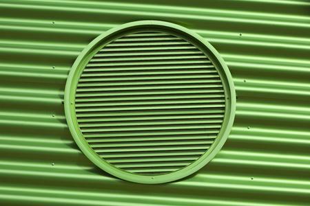 metal grate: Green metal air grate in a green metal building Stock Photo