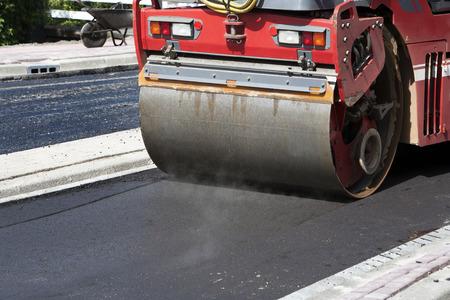 steamroller: Steamroller in action on asphalt