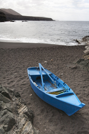 rowing boat: Blue rowing boat on the beach of Ajuy on the island Fuerteventura