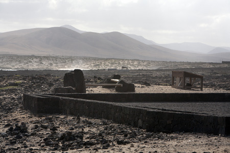 natural moody: Dark landscape of  waste and furniture on a cloudy day on Fuerteventura Stock Photo
